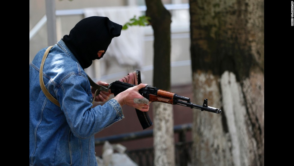 A pro-Russian gunman holds his weapon while guarding the local administration building in Slovyansk on May 6.