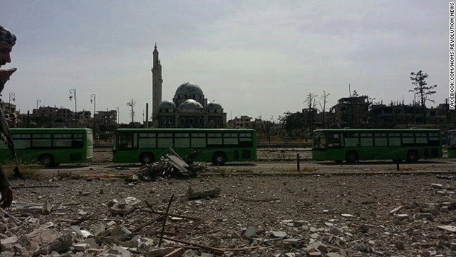Rebels begin evacuation of Homs