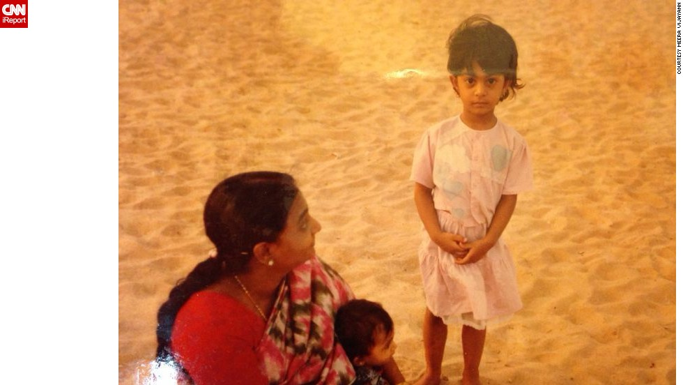 "Indian iReporter <a href=""http://ireport.cnn.com/docs/DOC-1126772"">Meera Vijayann</a>, pictured standing next to her grandmother and younger sister, spent much of her childhood in Kollam, a small port town along the country's southern coast. As a young girl she was brought up to respect her elders, a common occurrence within Indian culture. As a result, she developed a deep bond with her grandmother. She explains: ""As a child, she was my source of strength, a vision of wisdom and womanhood so powerful..."""