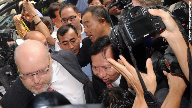 Thomas Kwok (C) is surrounded by the media and security as he arrives at court in Hong Kong on October 12, 2012.