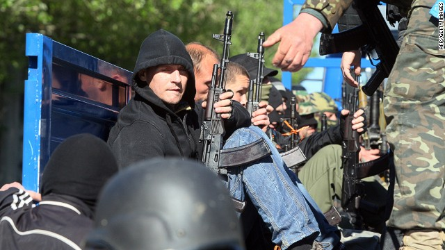 Armed pro-Russian militants board a truck in the eastern Ukrainian city of Donetsk on May 6, 2014.