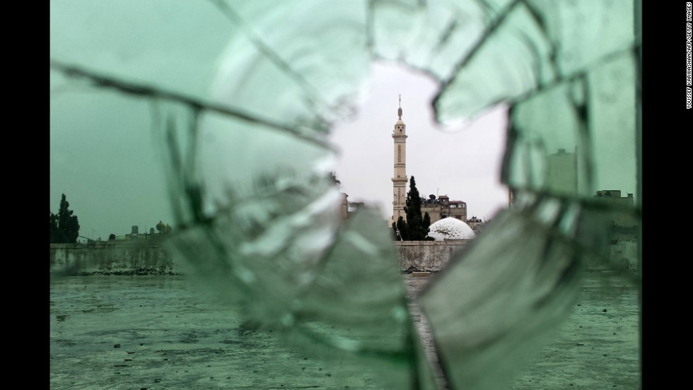 A mosque is seen through shattered glass in Homs, where an evacuation truce went into effect on Wednesday, May 7.