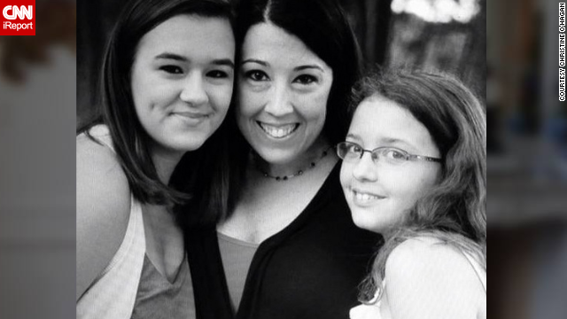 Christine O'Hagan with her two daughters in August 2013.