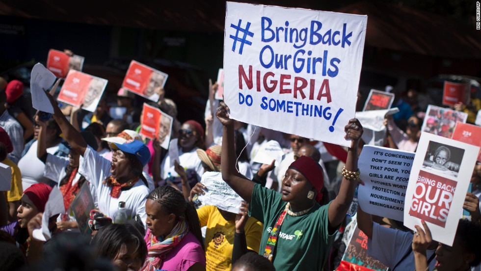 "During a march to the Nigerian Consulate in Johannesburg on Thursday, May 8, protesters call for the Nigerian government to rescue nearly 300 schoolgirls who were kidnapped last month in Chibok, Nigeria. The girls were taken by the Islamist militant group Boko Haram, which means ""Western education is sin,"" and the abductions <a href=""http://www.cnn.com/2014/05/01/world/gallery/nigeria-girls-kidnapped/index.html"">have sparked a global outcry</a>."