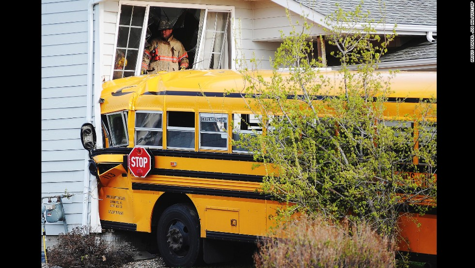 "Rescue personnel work at the site where a school bus crashed into a house in Sioux Falls, South Dakota, on Tuesday, May 6. There were no children on the bus at the time of the crash, which police said was caused when the 66-year-old driver experienced a medical-related issue, according to the <a href=""http://www.argusleader.com/story/news/crime/2014/05/06/bus-hits-two-houses-sioux-falls/8757671/"" target=""_blank"">Argus Leader newspaper</a>. He was taken to the hospital with a head injury."