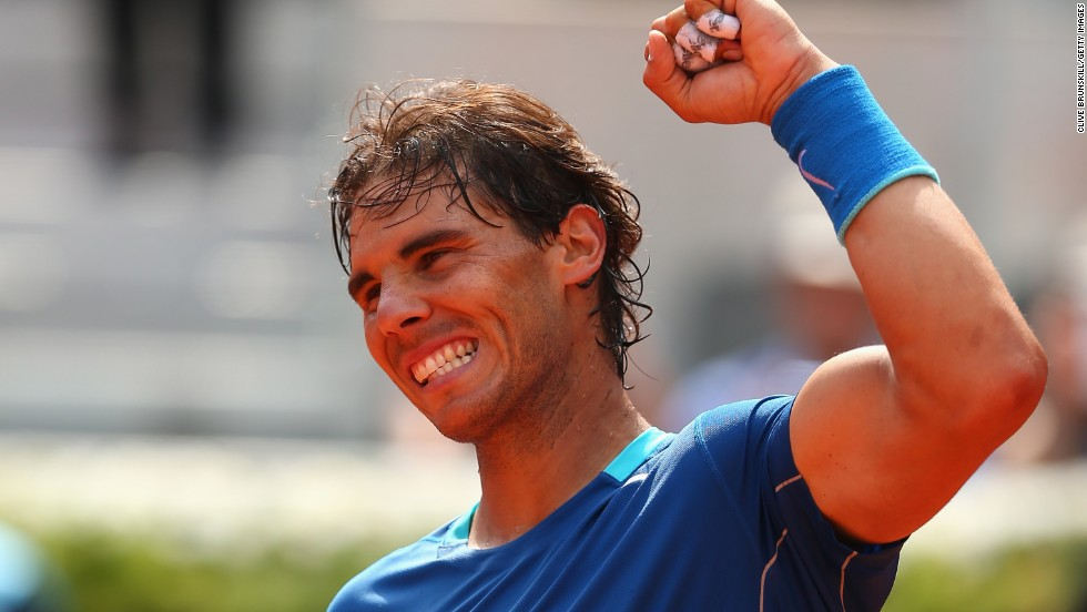 Rafael Nadal celebrates in typical style after completing his straight sets win over Jarkko Nieminen in Madrid.