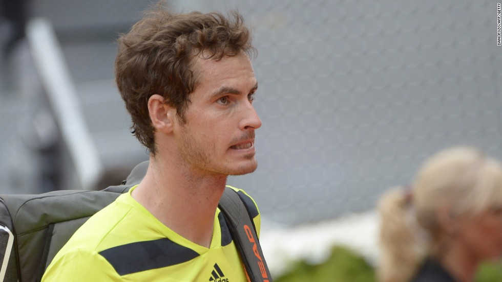 Wimbledon champion Andy Murray trudges off after his straight sets defeat to Santiago Giraldo.