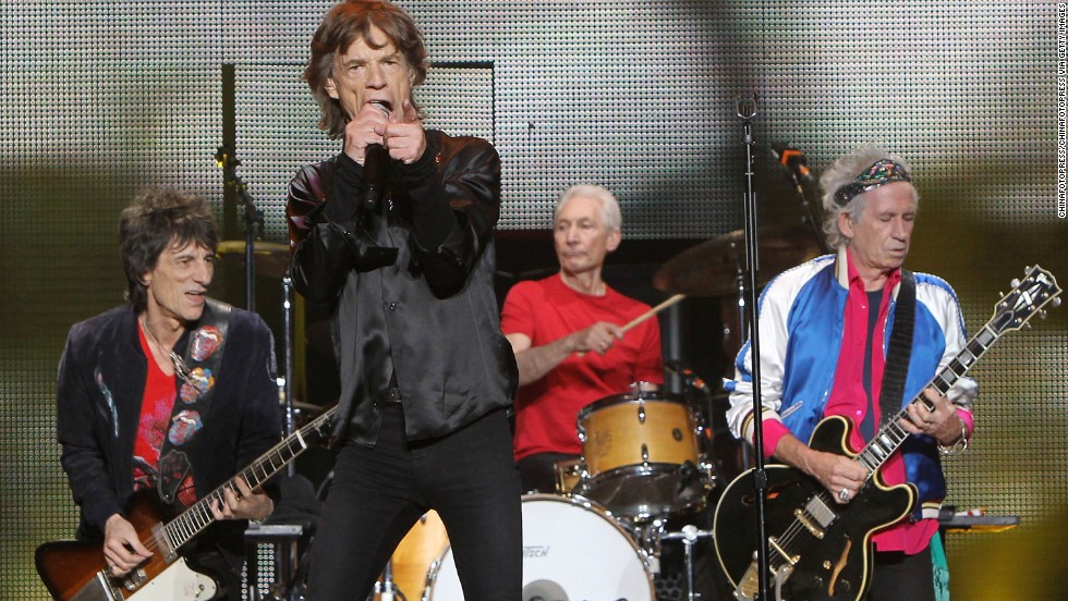 "The Rolling Stones formed in 1962 and, while the band has taken breaks, it's never broken up. According to The Rock and Roll Hall of Fame, they hold the record for band longevity. The Stones represented the opposite of the Beatles, according to the biography, epitomizing ""the darker, bluesier and more boldly sexual side of rock and roll."" They are due to play Australian and New Zealand later this year, after postponing due to the death of singer Mick Jagger's partner, designer L'Wren Scott. Here, Ronnie Wood, Mick Jagger, Charlie Watts and Keith Richards perform at the Mercedes-Benz Arena on March 12, 2014 in Shanghai, China."