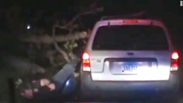 dnt tree falls on police officer during stop_00003319.jpg