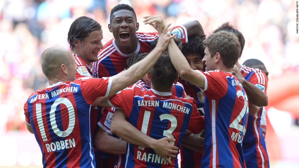 Bayern players surround Claudio Pizarro after his injury time winner in the 1-0 victory over Stuttgart.