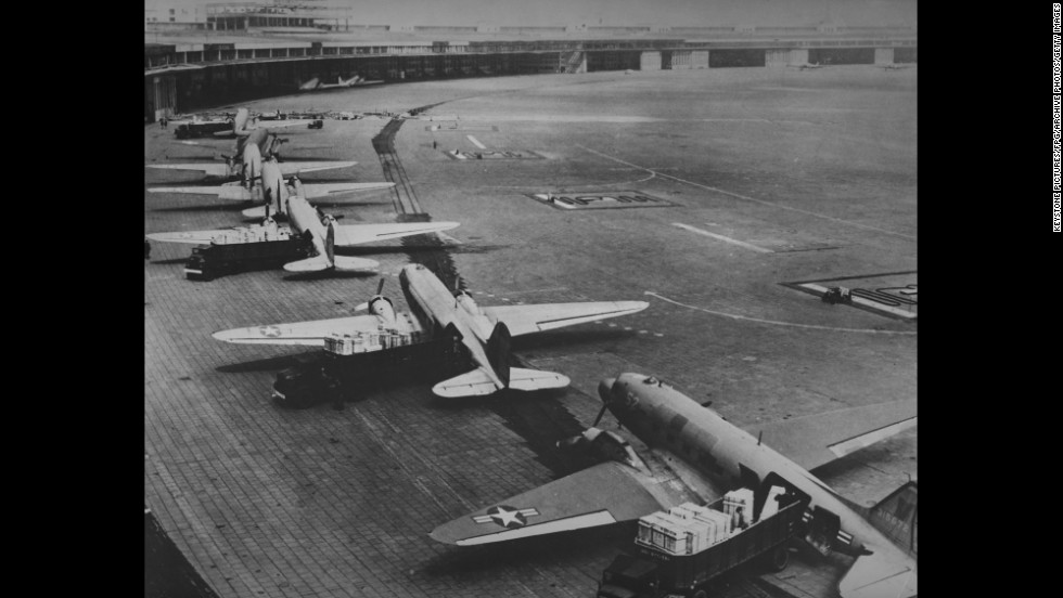 A U.S. Air Force Douglas C-47 Skytrain transport aircraft waits in the unloading line at Tempelhof Airport.
