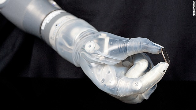 The DEKA bionic arm can control multiple joints simultaneously to pick up small objects such as this coin.