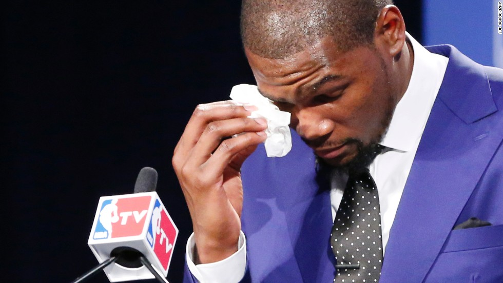 "Oklahoma City Thunder's <a href=""http://www.cnn.com/video/data/2.0/video/sports/2014/05/07/sot-kevin-durant-mvp-speech.nba-tv.html"">Kevin Durant gets emotional</a> during his speech after he won the NBA's most valuable player award on Tuesday, May 6. He elicited a standing ovation when he spoke of the hardships his mother endured. ""You're the real MVP,"" Durant said to her as she sat in the audience crying."