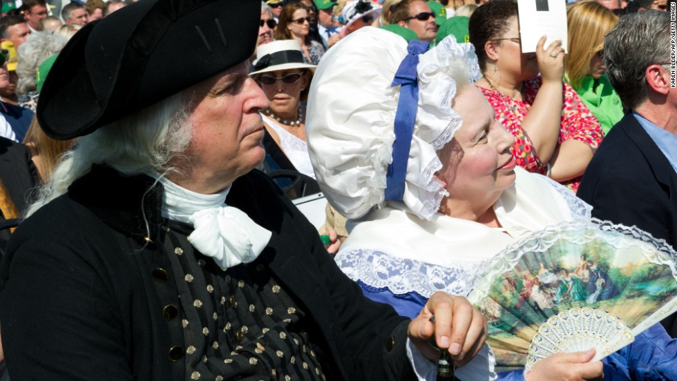 Re-enactors portraying President George Washington and his wife, Martha, attend the reopening celebrations. Built as a tribute to Washington's military leadership during the American Revolution, construction of the Washington Monument was started in 1848 and completed in 1884.
