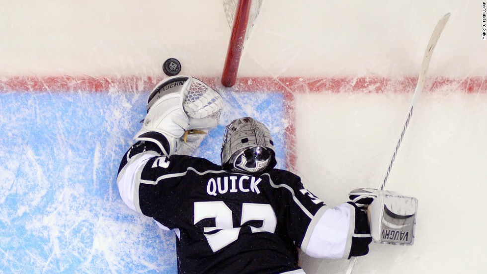 Los Angeles Kings goalie Jonathan Quick reaches for the puck after being scored on by Anaheim Ducks right wing Teemu Selanne in Game 3 of an NHL second-round Stanley Cup playoff series in Los Angeles on Thursday, May 8. The Ducks won 3-2.