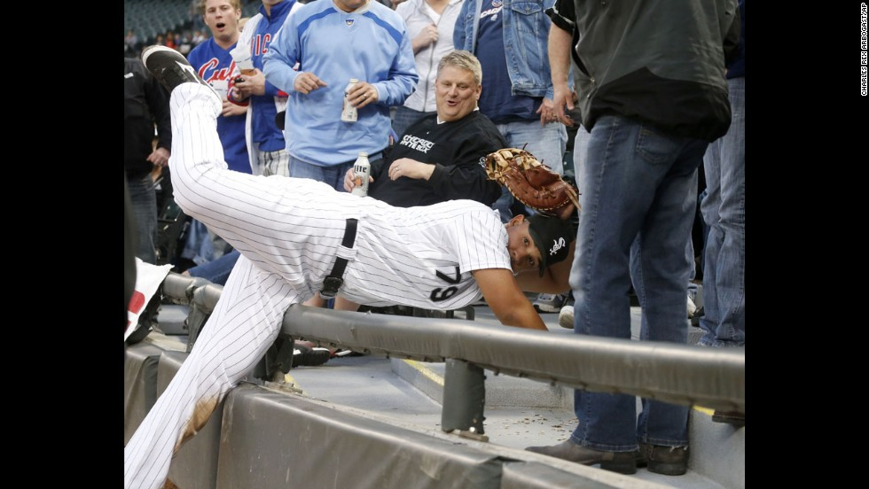 Chicago White Sox first baseman Jose Abreu shows his glove to the first base umpire after catching a fly ball off the bat of Darwin Barney of the Chicago Cubs at U.S. Cellular Field in Chicago on Wednesday, May 7.