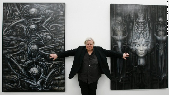 H.R. Giger  poses with two of his works at the art museum in Chur, Switzerland, in 2007.