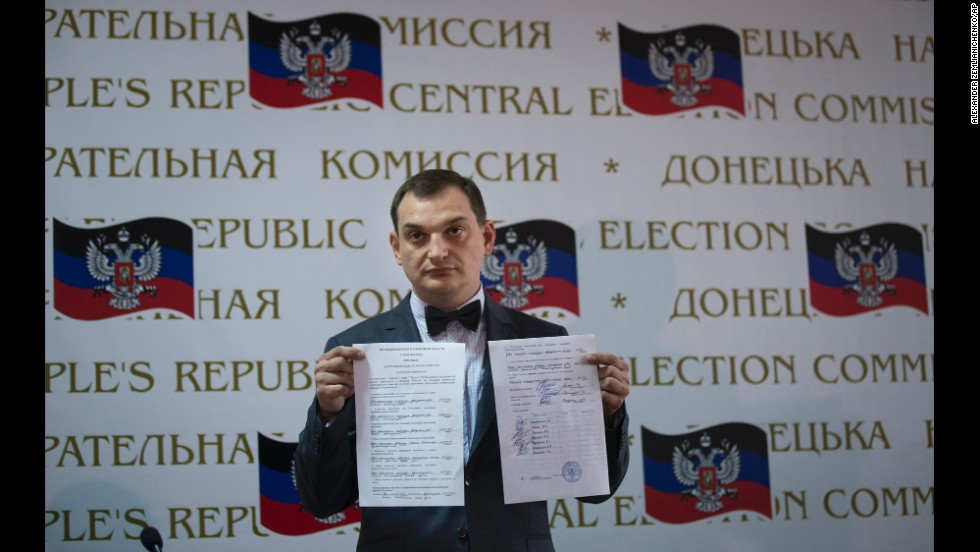 Roman Lyagin, a member of a rebel election commission, shows referendum results to journalists at a May 12 news conference in Donetsk. Pro-Russian separatists staged the referendum asking residents in the Donetsk and Luhansk regions whether they should declare independence from Ukraine.