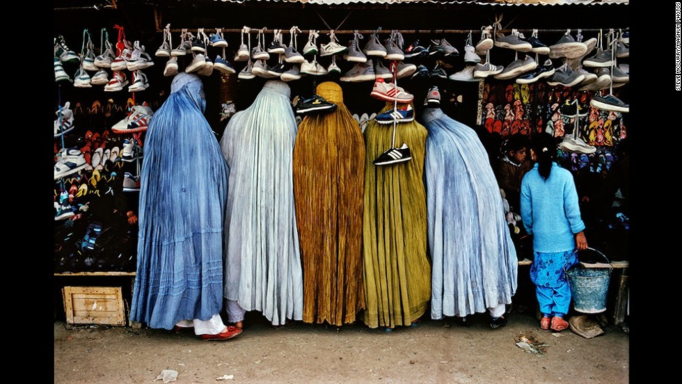Afghan women shop at a shoe store in Kabul, 1992.
