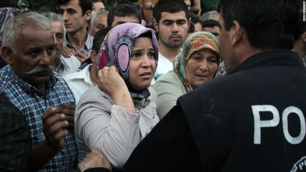 Relatives try to get information outside a Soma hospital on Tuesday, May 13.