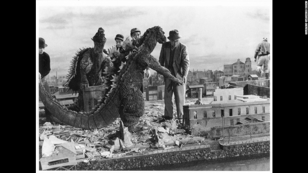 "Tsuburaya supervises an effects scene from 1955's ""Godzilla Raids Again."" The Godzilla costume was considerably thinner than the one used in the first movie."