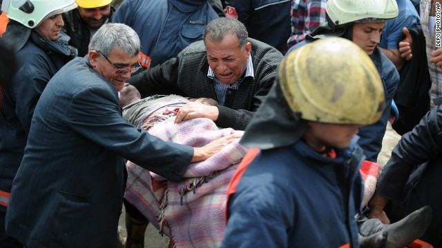 A man cries over the body of a miner after being pulled from the mine in Soma on May 14.