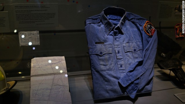 NEW YORK, NY - MAY 14: A firefighters shirt used at Ground Zero on September 11 is viewed during a tour the National September 11 Memorial Museum on May 14, 2014 in New York City. The long awaited museum will open to the public on May 21 following a six-day dedication period for 9/11 families, survivors, first responders ,workers, and local city residents. For the dedication period the doors to the museum will be open for 24-hours a day from May 15 through May 20. On Thursday President Barack Obama and the first lady will attend the dedication ceremony for the opening of the museum. While the construction of the museum has often been fraught with politics and controversy, the exhibitions and displays seek to pay tribute to the 2,983 victims of the 9/11 attacks and the 1993 bombing while also educating the public on the September 11 attacks on the World Trade Center, the Pentagon and in Pennsylvania.  (Photo by Spencer Platt/Getty Images)