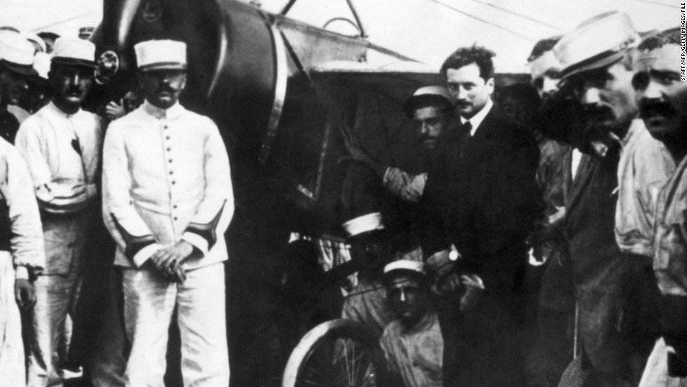 Garros (fourth from the right) poses among Spahis of the French army in front of the Morane-Saulnier plane which he piloted across the Mediterranean Sea on September 23, 1913.