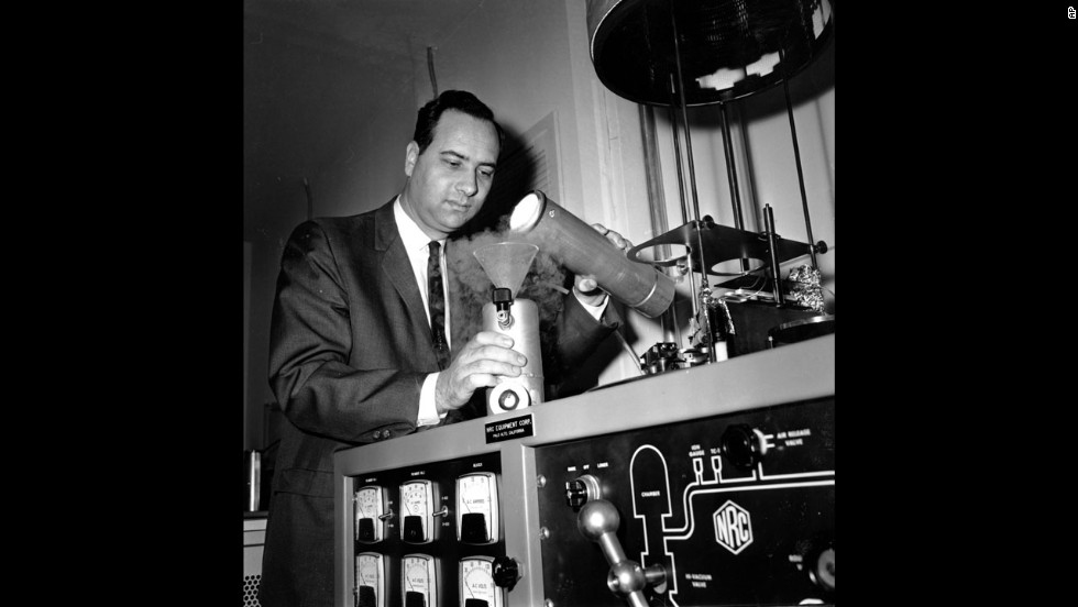 Theodore Maiman pours liquid nitrogen into a cooling unit around one of the first experimental lasers in his laboratory in Santa Monica, California. Maiman's ruby laser, created on May 16, 1960, is considered to be one of the top technological achievements of the 20th century. It paved the way for fiber-optic communications, CDs, DVDs and sight-restoring surgery.