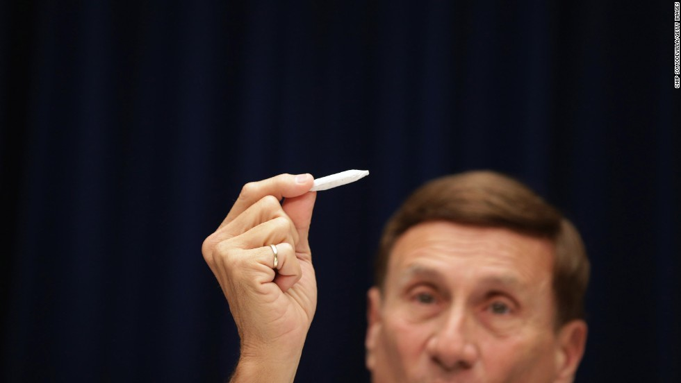 "U.S. Rep. John Mica of Florida holds a fake joint Friday, May 9, during a House subcommittee hearing about marijuana laws in the nation's capital. The District of Columbia is looking to decriminalize possession of the drug. ""Don't get too excited,"" Mica said of the prop, which he said was rolled by members of his staff."