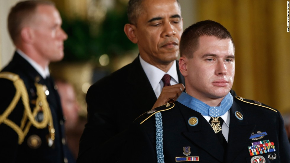 "U.S. President Barack Obama awards the Medal of Honor to Army Sgt. Kyle J. White during a White House ceremony on Tuesday, May 13. White was recognized for repeatedly exposing himself to enemy fire in Afghanistan while trying to save the lives of fellow soldiers in November 2007. He is the 10th person to receive the military's highest honor for actions in Afghanistan. <a href=""http://www.cnn.com/2014/05/13/politics/gallery/afghanistan-vets-medal-of-honor/index.html"">See all 10</a>"