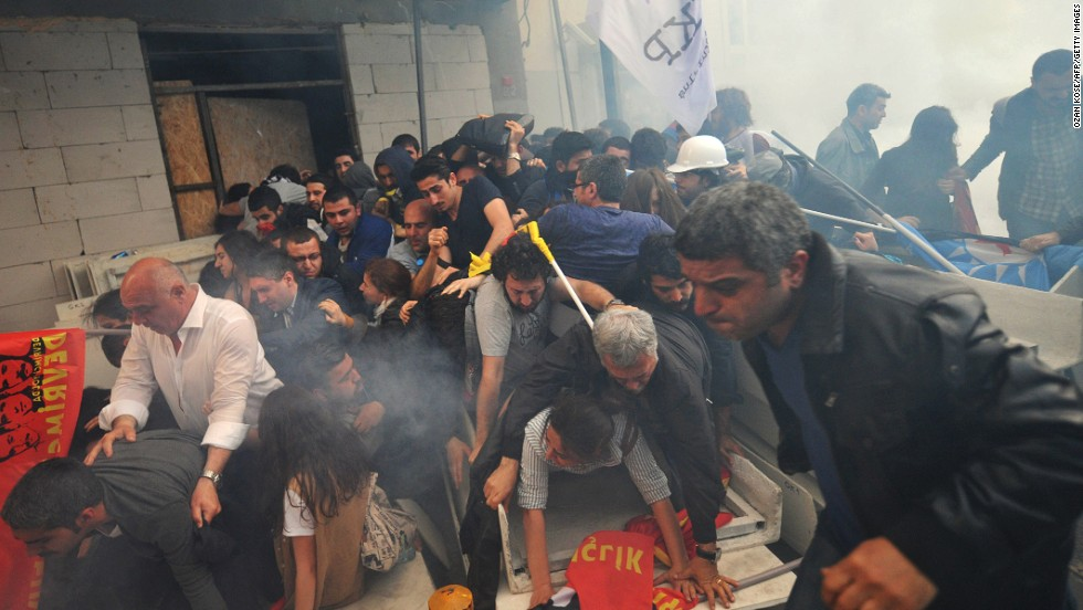"People protesting <a href=""http://www.cnn.com/2014/05/13/europe/gallery/turkey-mine-accident/index.html"">the Turkish mine disaster</a> run away from tear gas during a demonstration in Istanbul on Wednesday, May 14."