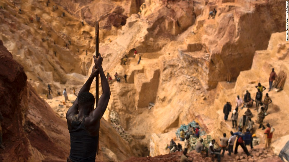 Prospectors work in an open pit Friday, May 9, at the Ndassima gold mine, which is near Djoubissi, Central African Republic.