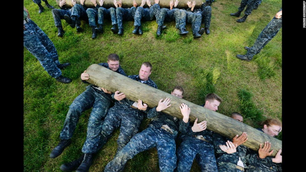 "Freshman midshipmen, known as ""plebes,"" perform situps with a log across their chests during Sea Trials, a day of physical and mental challenges that caps off their first year at the U.S. Naval Academy in Annapolis, Maryland, on Tuesday, May 13."