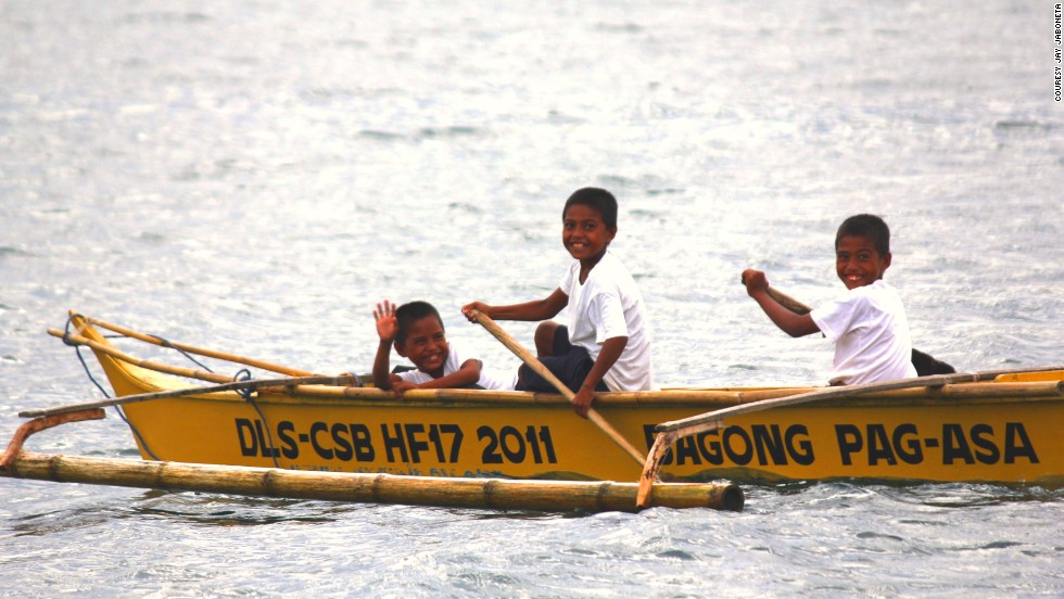 Children from the village of Layag-Layag use one of the donated boats to get to school. Before they had to swim.