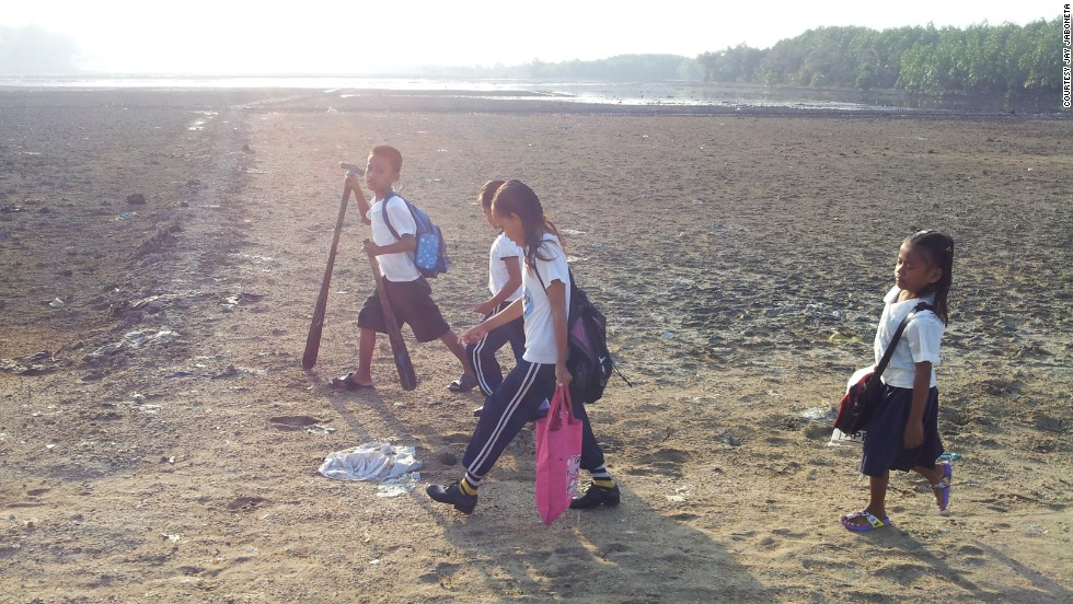 At low tide the journey to school might only mean wading through mangroves, while other children from nearby Zaboanga del Sur had to embark on a three-hour walk along around a snake-infested lake.