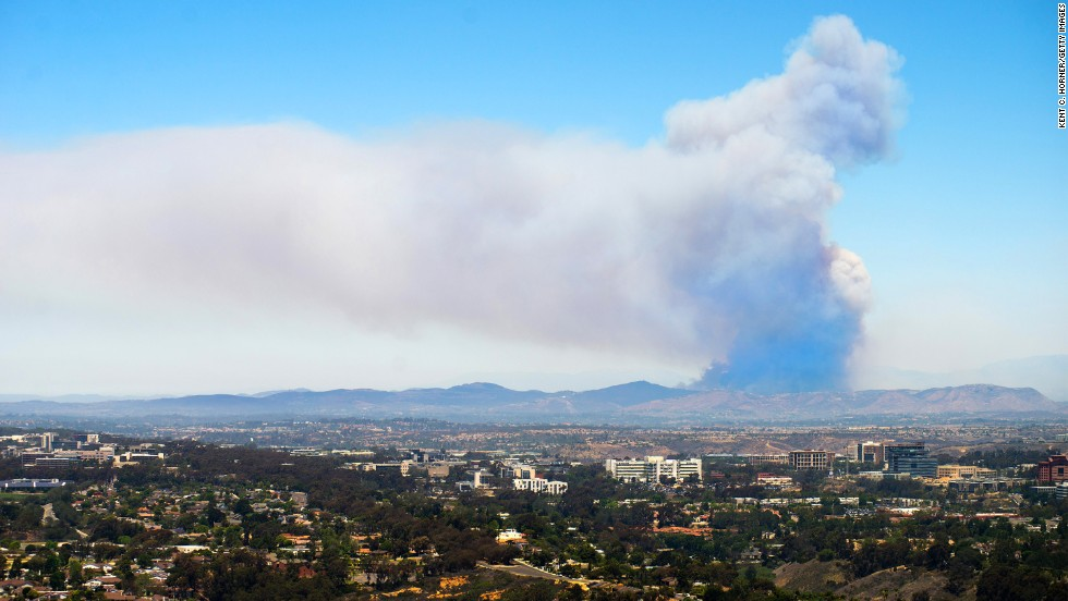 A huge plume of smoke in San Marcos is seen on May 15 from atop Mount Soledad in La Jolla, California.