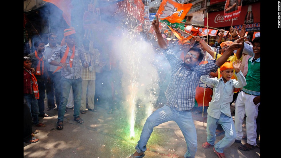 BJP supporters dance and set off firecrackers at the news of election results in Allahabad on May 16.