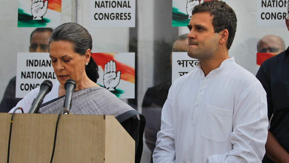 Sonia Gandhi, leader of the Indian National Congress, addresses reporters May 16 outside party headquarters in New Delhi, with her son and party Vice President Rahul Gandhi at her side. Rahul Gandhi said he took responsibility for the defeat of the Congress party, which had dominated Indian politics since the nation's independence in 1947.