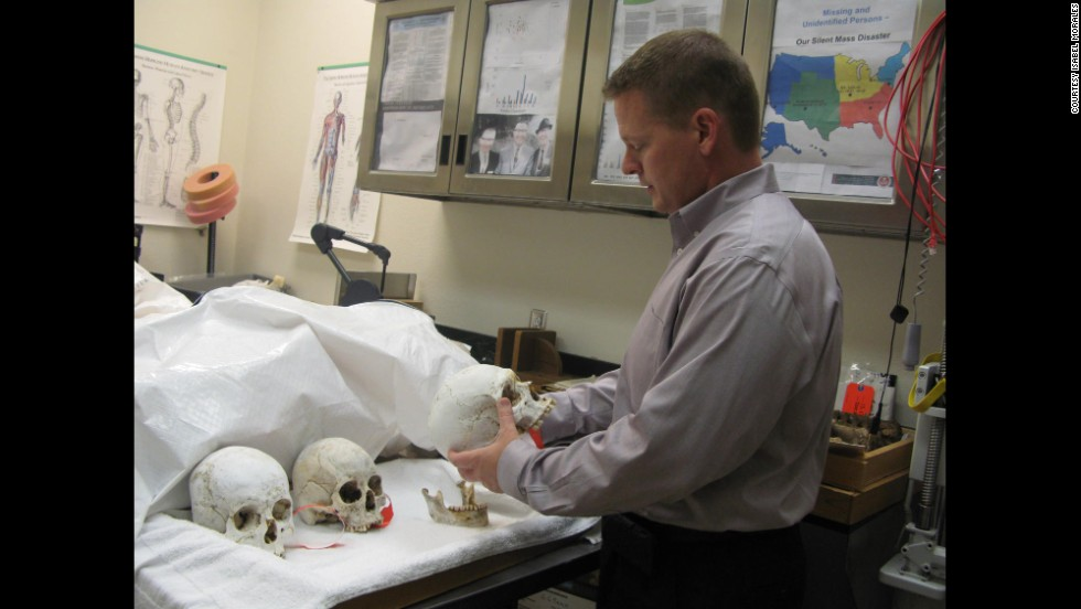 Gregory Hess, the coroner in Pima County, Arizona, inspects some human remains kept at the morgue. Since 2001, more than 2,000 migrants have been found dead in the Arizona desert, many of them without any identification.