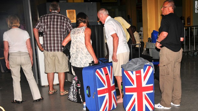 British tourists queue to prepare to leave the international airport in Mombasa, Kenya on May 15, 2014.