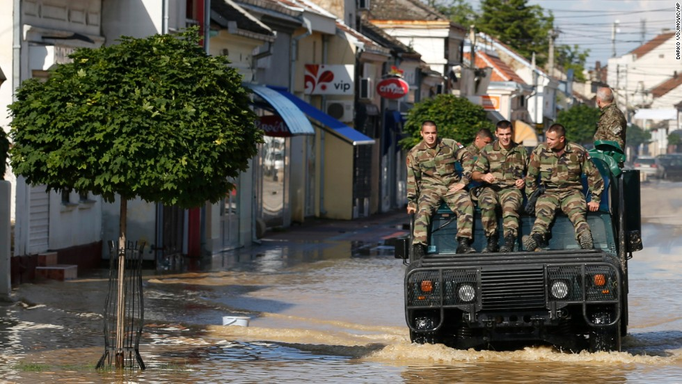 A police vehicle drives through a flooded street in Obrenovac on May 18.