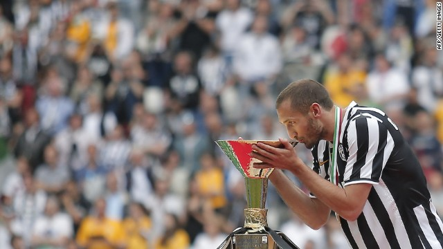 Juventus defender Giorgio Chiellini kisses the league trophy after their 3-0 victopry over Cagliari.