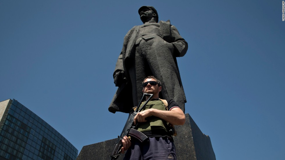 A bodyguard of insurgent leader Denis Pushilin stands in front of a statue of Russian revolutionary Vladimir Lenin during a pro-Russia rally in Donetsk on May 18.