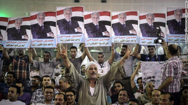 Supporters of Egyptian leftist presidential candidate Hamdeen Sabahi (portrait) attend a campaign meeting in Cairo.