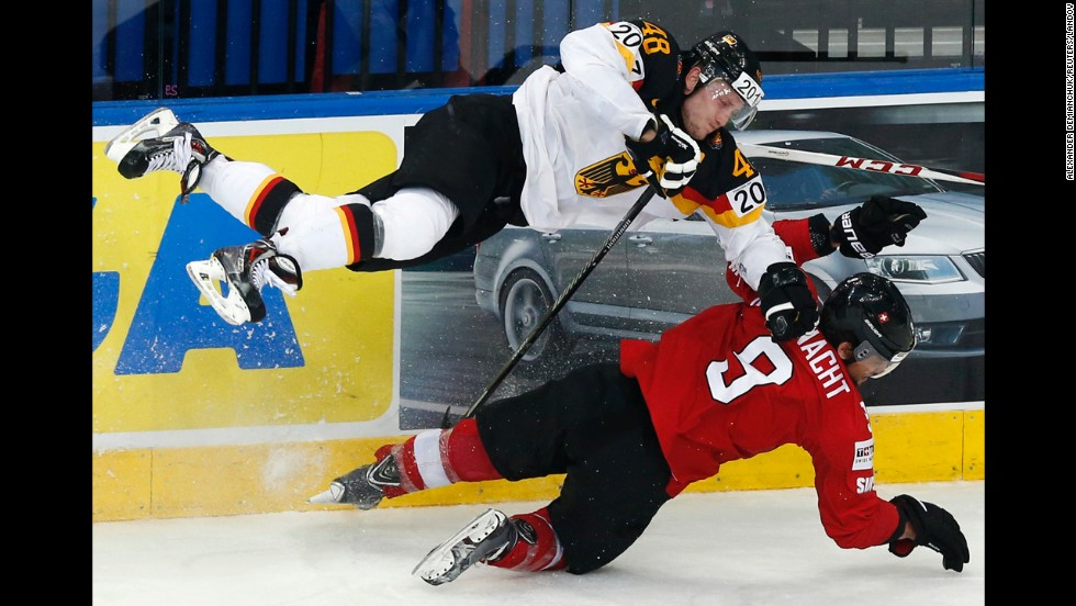 Switzerland's Thomas Rufenacht, bottom, collides with Germany's Frank Hordler during a game Wednesday, May 14, at the Ice Hockey World Championship in Minsk, Belarus. Switzerland won the game 3-2, but neither team was able to advance out of the group stage of the tournament, which ends later this month.