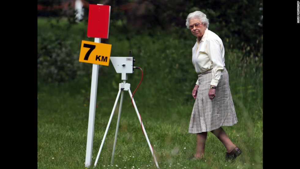 Britain's Queen Elizabeth II watches competitors in the Land Rover International Driving Grand Prix, an equestrian event held Saturday, May 17, at Windsor Castle in Windsor, England. The Royal Windsor Horse Show has been held annually since 1943.