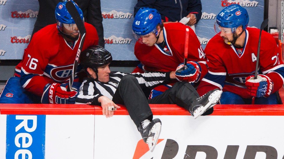 Linesman Steve Barton is helped up after he fell into the Montreal Canadiens' bench Saturday, May 17, in Game 1 of the NHL's Eastern Conference finals. Montreal lost 7-2 in the series-opening game against the New York Rangers.