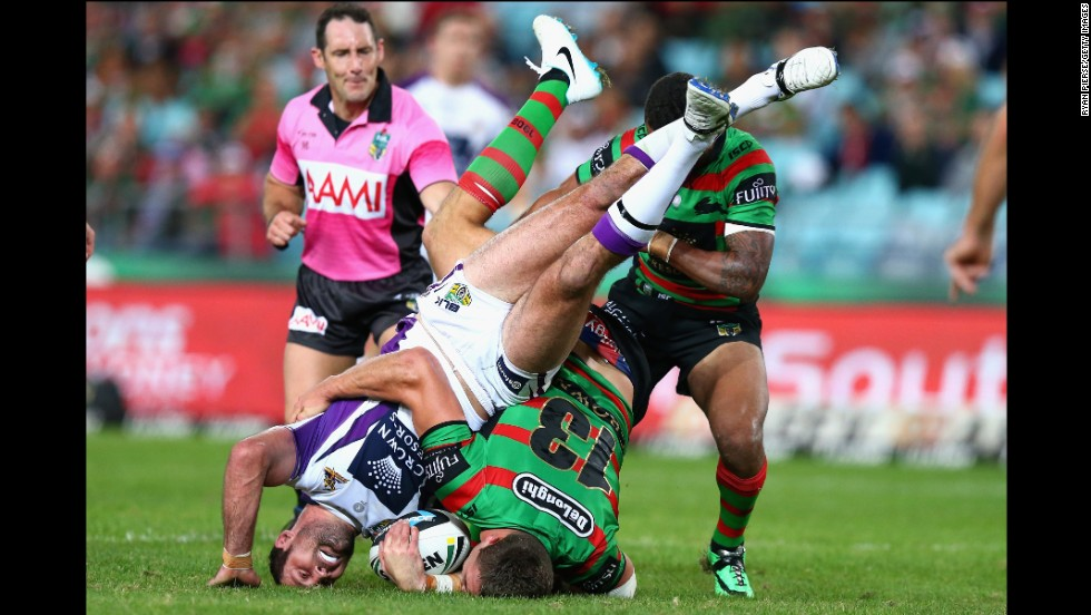 Bryan Norrie of the Melbourne Storm is tackled by Sam Burgess of the South Sydney Rabbitohs during a National Rugby League match Friday, May 16, in Sydney. The Storm won the match 27-14.