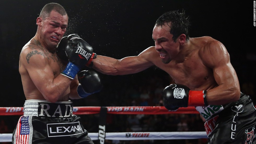Juan Manuel Marquez lands a right hand to Mike Alvarado's chin in their welterweight bout Saturday, May 17, in Inglewood, California. Marquez won by unanimous decision.
